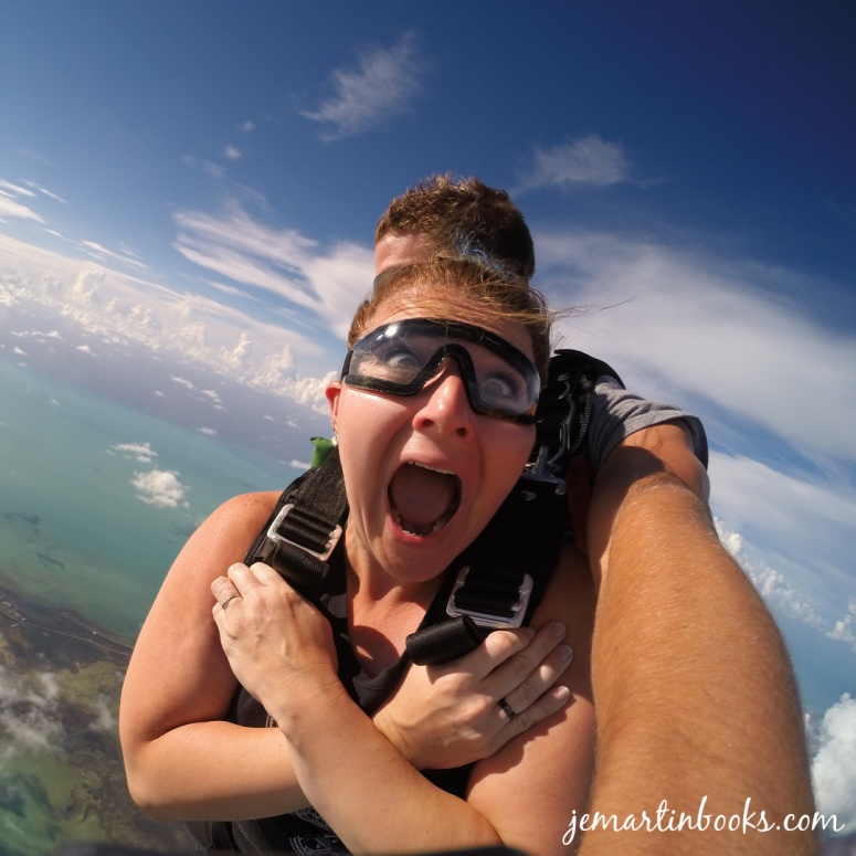 Image of a woman shouting with wide eyes during a sky dive